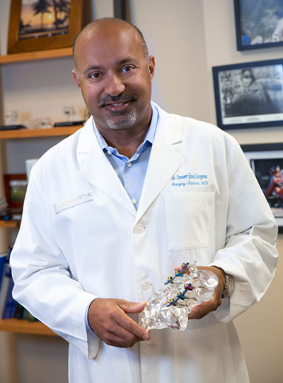 Dr. Sanjay Jatana posing with fusion implant demo